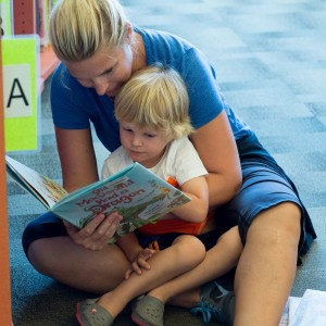 mother and toddler reading